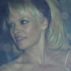 Thumbnail image for Pam Anderson Pops Out a Boob in the Backseat