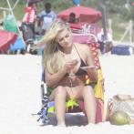 Brazilian Playmate Thaiz Schmitt Frolics on the Beach in a Thong 3
