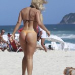 Brazilian Playmate Thaiz Schmitt Frolics on the Beach in a Thong 12
